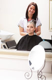 Hairstylist dyeing hair woman client in hairdressing beauty salon Royalty Free Stock Photography