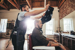 Hairstylist giving hair cute to customer Stock Images