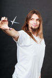 Hairstylist with scissors in hand Royalty Free Stock Images