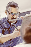 Hairstylist shaving a beard Royalty Free Stock Images