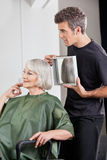Hairstylist Showing Finished Haircut To Customer Royalty Free Stock Photos