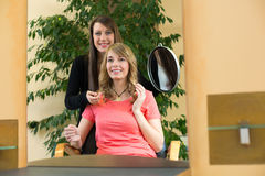Hairstylist shows client her new haircut Royalty Free Stock Images