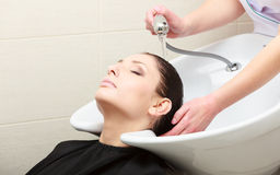 Hairstylist washing woman hair. Hairdressing beauty salon Royalty Free Stock Images