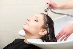 Hairstylist washing woman hair. Salon. Royalty Free Stock Photography