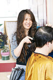 Hairstylist working Stock Images