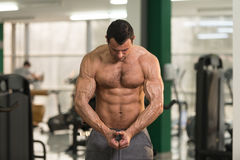 Hairy Bodybuilder Flexing Muscles. Hairy Handsome Young Man Standing Strong In The Gym And Flexing Muscles - Muscular Athletic Bodybuilder Fitness Model Posing Royalty Free Stock Photo