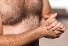 Hairy chest of a man in the open air Stock Image