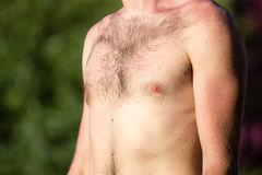 Hairy chest of a man in the open air Stock Photo