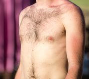 Hairy chest of a man in the open air.  Royalty Free Stock Image