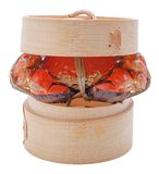 Hairy crabs on the Bamboo steamer Isolated in Stock Image