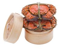 Hairy crabs on the Bamboo steamer Isolated in Royalty Free Stock Photography