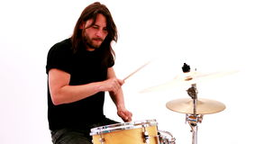 Hairy drummer playing his drum kit stock footage