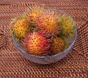 Hairy Fruit Rambutan Indonesia in glass bowl. Picture of Hairy Fruit Rambutan Indonesia in glass bowl Stock Images