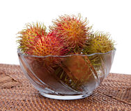 Hairy Fruit Rambutan Indonesia in glass bowl Royalty Free Stock Images