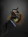 Hairy hand holding cell phone Stock Photo