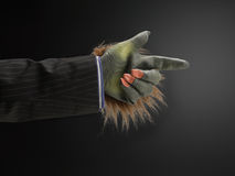 Hairy hand pointing. Against gray background Stock Image
