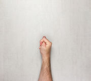 Hairy men hand shows the gesture of a Fig on a grey background Stock Photography