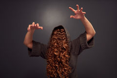 Hairy woman frightening over dark Royalty Free Stock Images