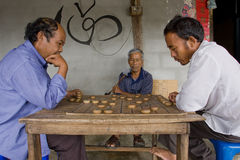 Hais men are playing Chinese chess - XiangQi Royalty Free Stock Photo