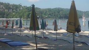 Haise longues and sun umbrellas on Phuket Patong beach. Clip stock video