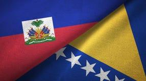 Haiti, Bo?nia i Herzegovina dwa flagi tekstylny p??tno, tkaniny tekstura zdjęcia royalty free