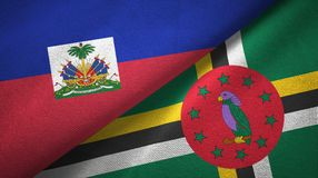 Haiti and Dominica two flags textile cloth, fabric texture. Haiti and Dominica two folded flags together royalty free stock photography
