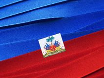 Haiti flag or banner. Made with red and blue ribbons royalty free stock image