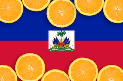 Haiti flag in citrus fruit slices horizontal frame. Haiti flag in horizontal frame of orange citrus fruit slices. Concept of growing as well as import and export royalty free stock photo