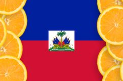 Haiti flag in citrus fruit slices vertical frame. Haiti flag in vertical frame of orange citrus fruit slices. Concept of growing as well as import and export of stock photos