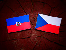 Haiti flag with Czech flag on a tree stump stock photo