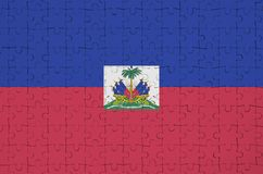 Haiti flag is depicted on a folded puzzle royalty free illustration
