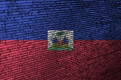 Haiti flag is depicted on the screen with the program code. The concept of modern technology and site development.  royalty free stock image
