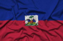 Haiti flag is depicted on a sports cloth fabric with many folds. Sport team banner. Haiti flag is depicted on a sports cloth fabric with many folds. Sport team royalty free stock photos