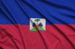 Haiti flag is depicted on a sports cloth fabric with many folds. Sport team banner. Haiti flag is depicted on a sports cloth fabric with many folds. Sport team vector illustration