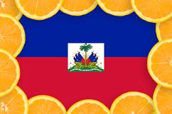 Haiti flag in fresh citrus fruit slices frame. Haiti flag in frame of orange citrus fruit slices. Concept of growing as well as import and export of citrus vector illustration