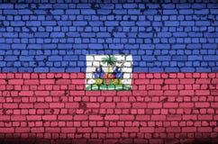 Haiti flag is painted onto an old brick wall vector illustration