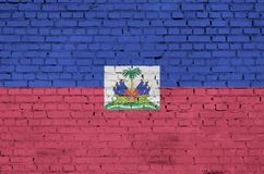 Haiti flag is painted onto an old brick wall stock image