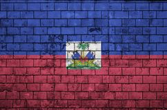 Haiti flag is painted onto an old brick wall royalty free stock photography