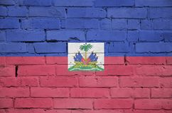 Haiti flag is painted onto an old brick wall stock photography