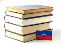 Haiti flag with pile of books on white background. Haiti flag with pile of books on white stock images