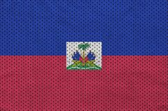 Haiti flag printed on a polyester nylon sportswear mesh fabric w. Ith some folds royalty free stock photos