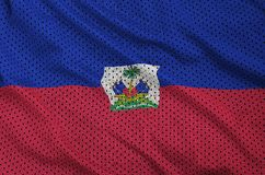 Haiti flag printed on a polyester nylon sportswear mesh fabric w. Ith some folds stock photos