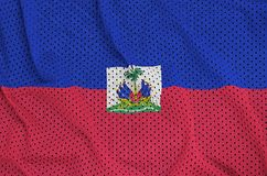 Haiti flag printed on a polyester nylon sportswear mesh fabric w. Ith some folds royalty free stock images