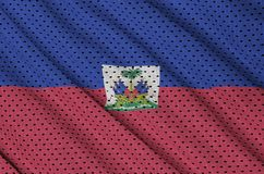 Haiti flag printed on a polyester nylon sportswear mesh fabric w. Ith some folds royalty free stock image