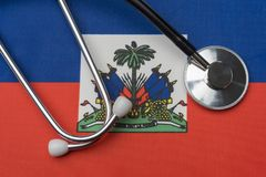 Haiti flag and stethoscope. The concept of medicine. Stethoscope on the flag as a background stock photos