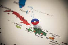 Haiti marked with a flag on the map.  royalty free stock photo