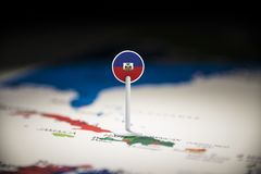 Haiti marked with a flag on the map.  stock photo