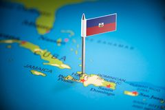 Haiti marked with a flag on the map.  stock photos