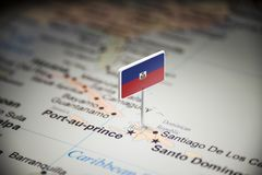 Haiti marked with a flag on the map.  royalty free stock photos