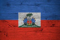 Haiti national flag coat arms painted old oak wood. Haiti national flag with coat of arms painted on old oak wood. Painting is colorful on planks of old train royalty free stock image